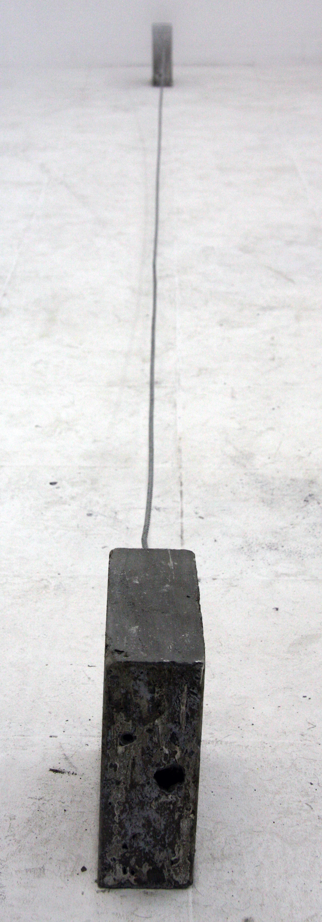 """""""Force of nature""""       Variable sizes, concrete, metal wire, ,metal rods,motor, hammer, video screening, 2011"""