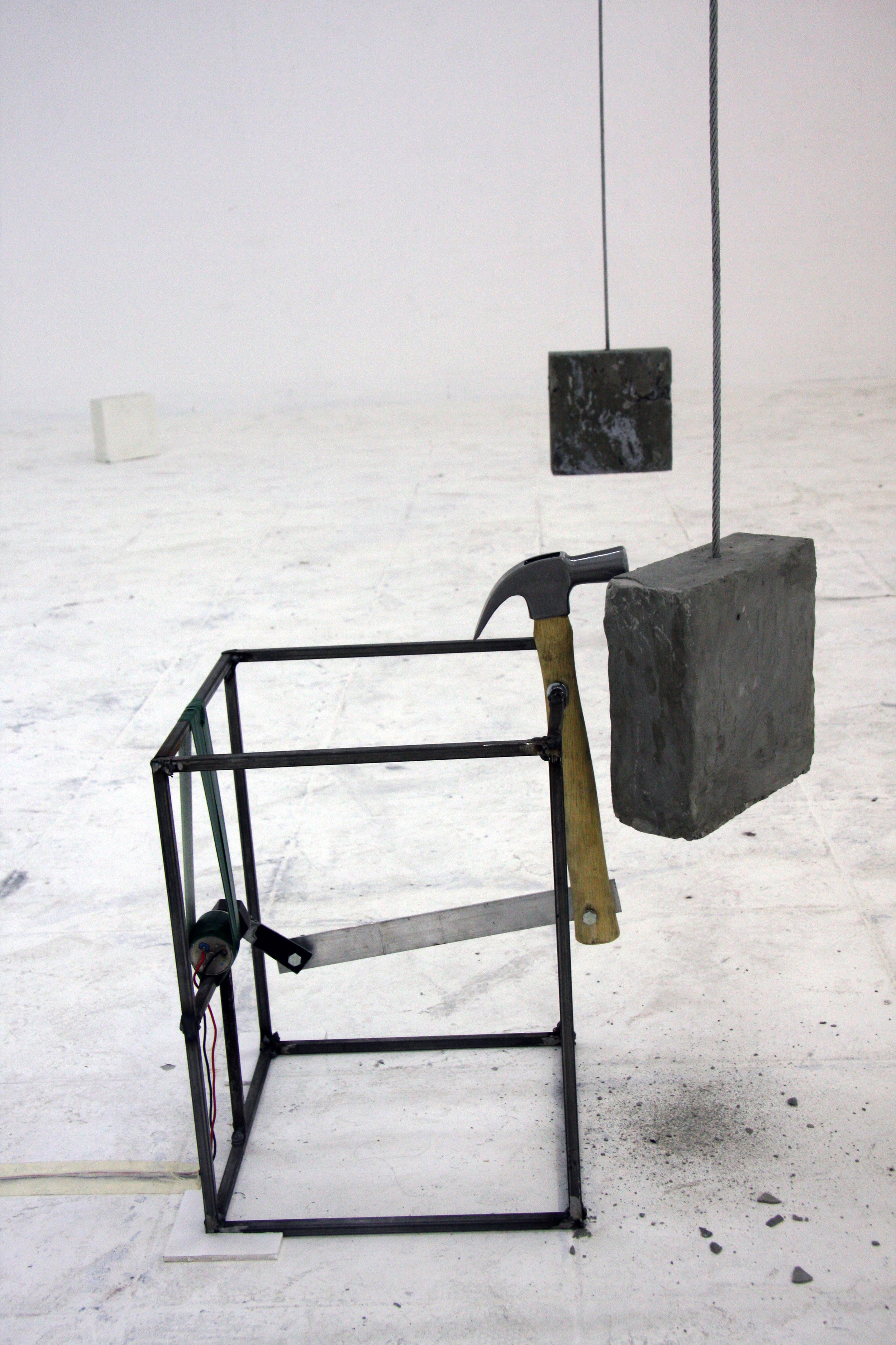 """Force of nature""              Variable sizes, concrete, metal wire, ,metal rods, motor, hammer, video screening, 2011"