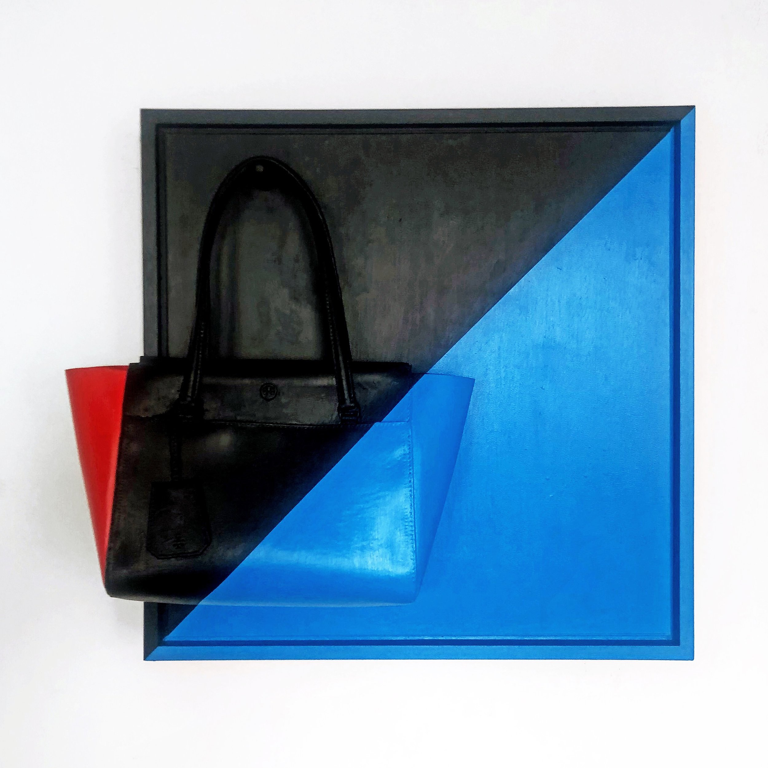 "Interlock object"" (Target no.102),  24X9 ½ X27, Tory Burch casted handbag and acrylic on wood frame, 2019"