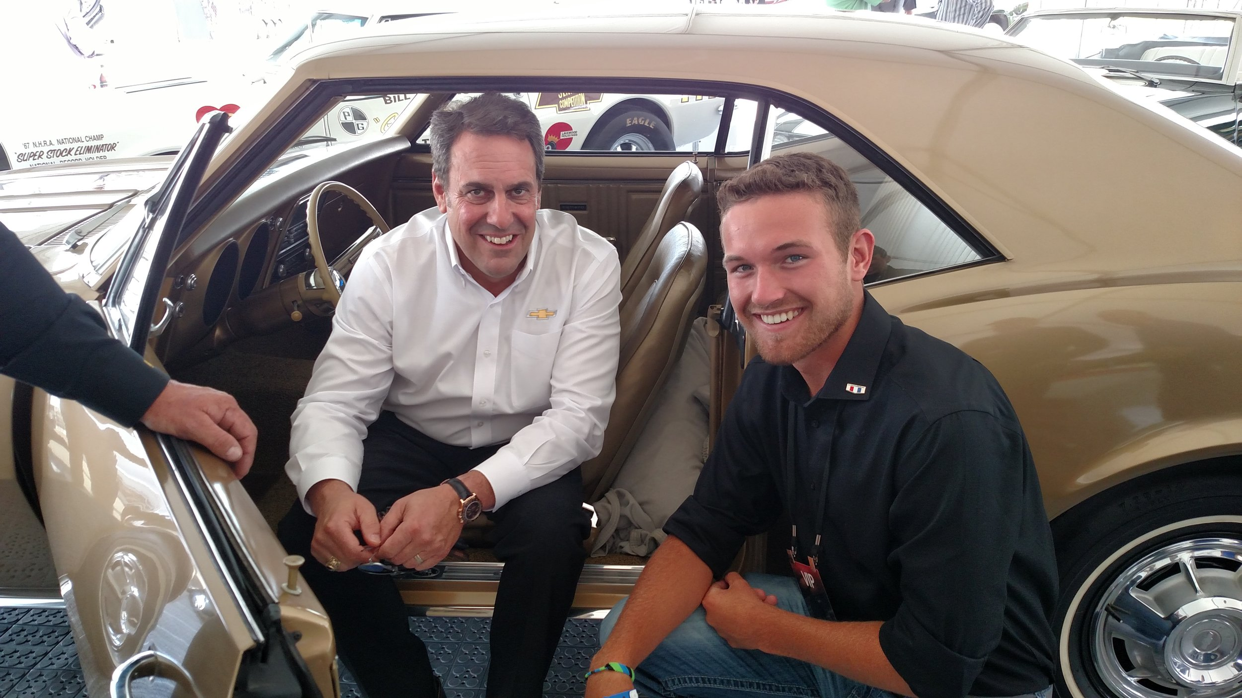 Mark Reuss, President of General Motors North America, and Logan Lawson of the Pilot Car Registry with the serial #1 Camaro.