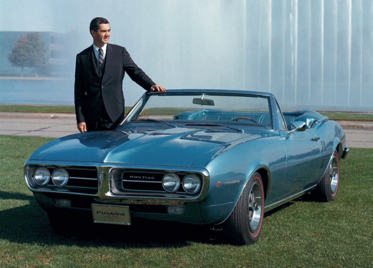 John DeLorean at GM with his new 1967 Firebird.