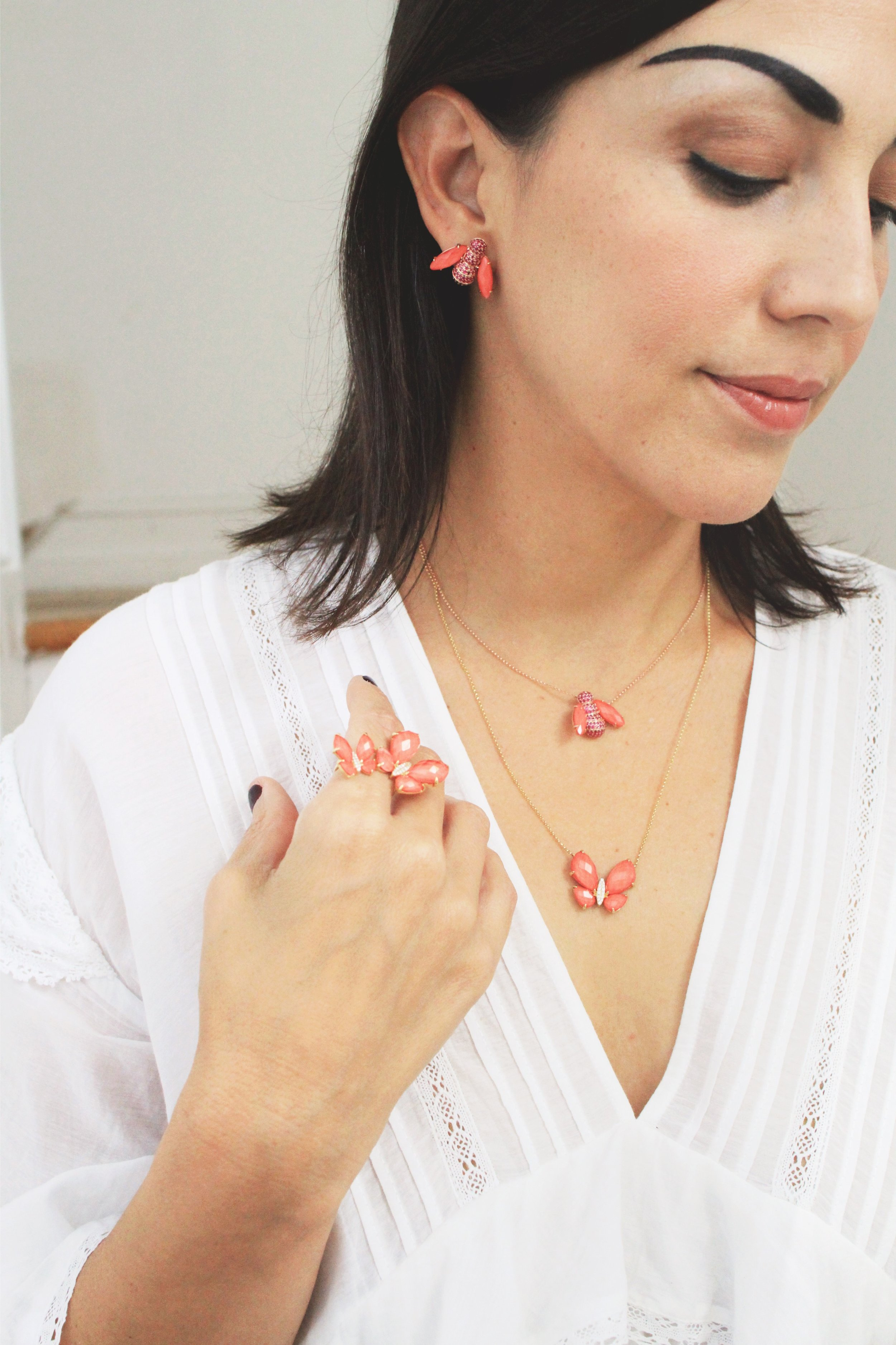 Coyly deciding if I'm keeping earrings or necklace. or both! Photo by Alana Harris