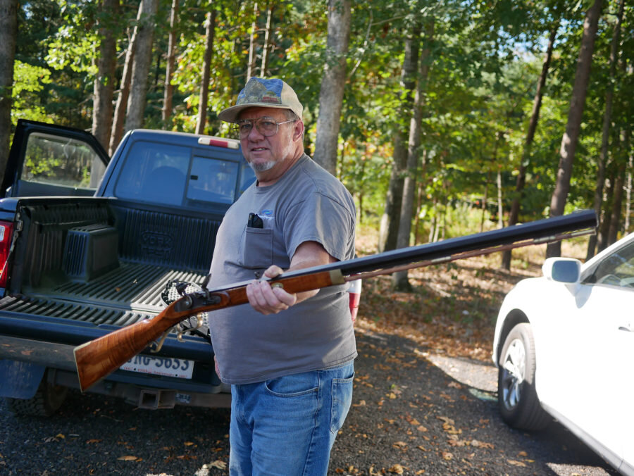 Dave Chavez holds a rifle he built himself and brought to the Izaak Walton League, where he shoots skeet with friends. He opposes stricter gun control.    WAMU / Daniella Cheslow