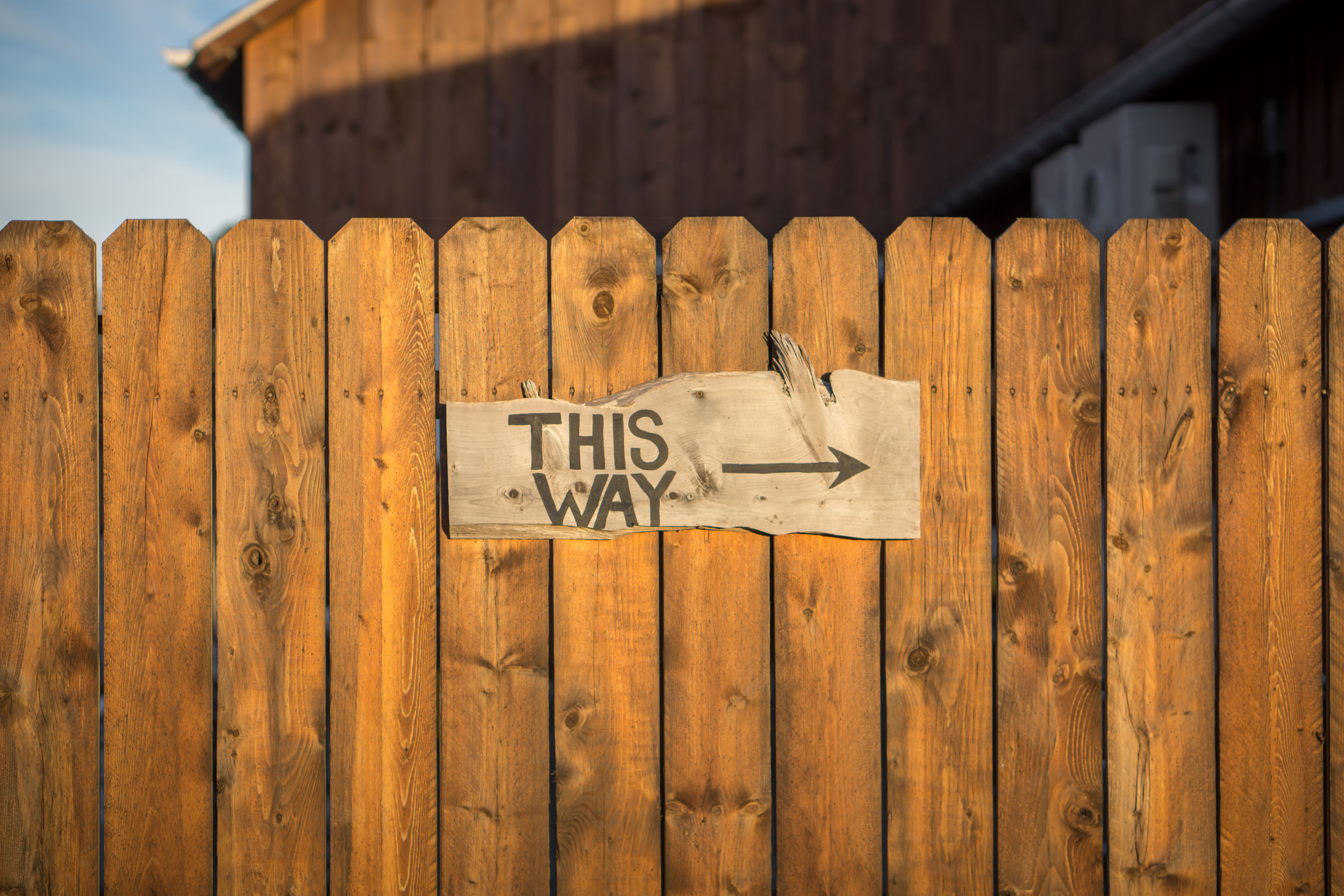 fence with this way written on it