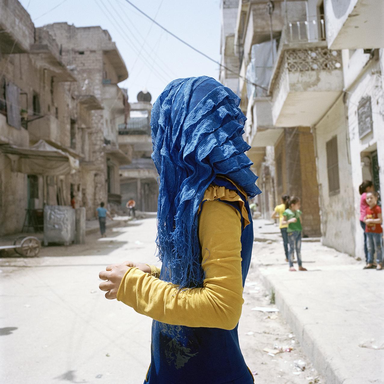 girl in blue hijab profile 100x100.jpg