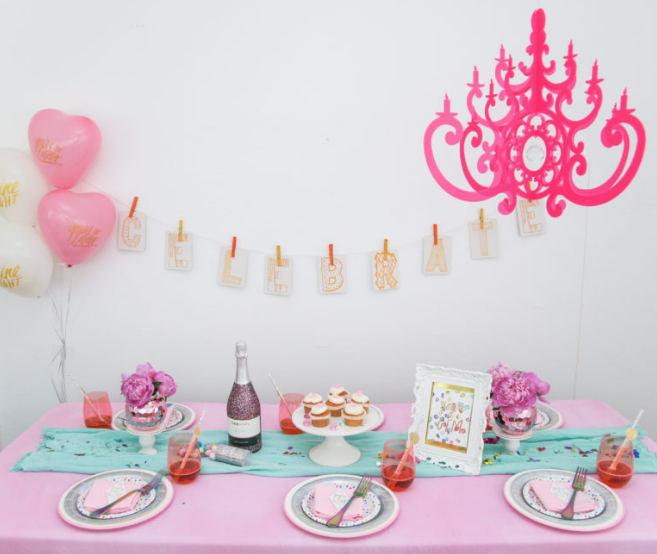 Jessica topped it all off with a perfect, pink chandelier that is light enough to hang from a command hook just about anywhere.