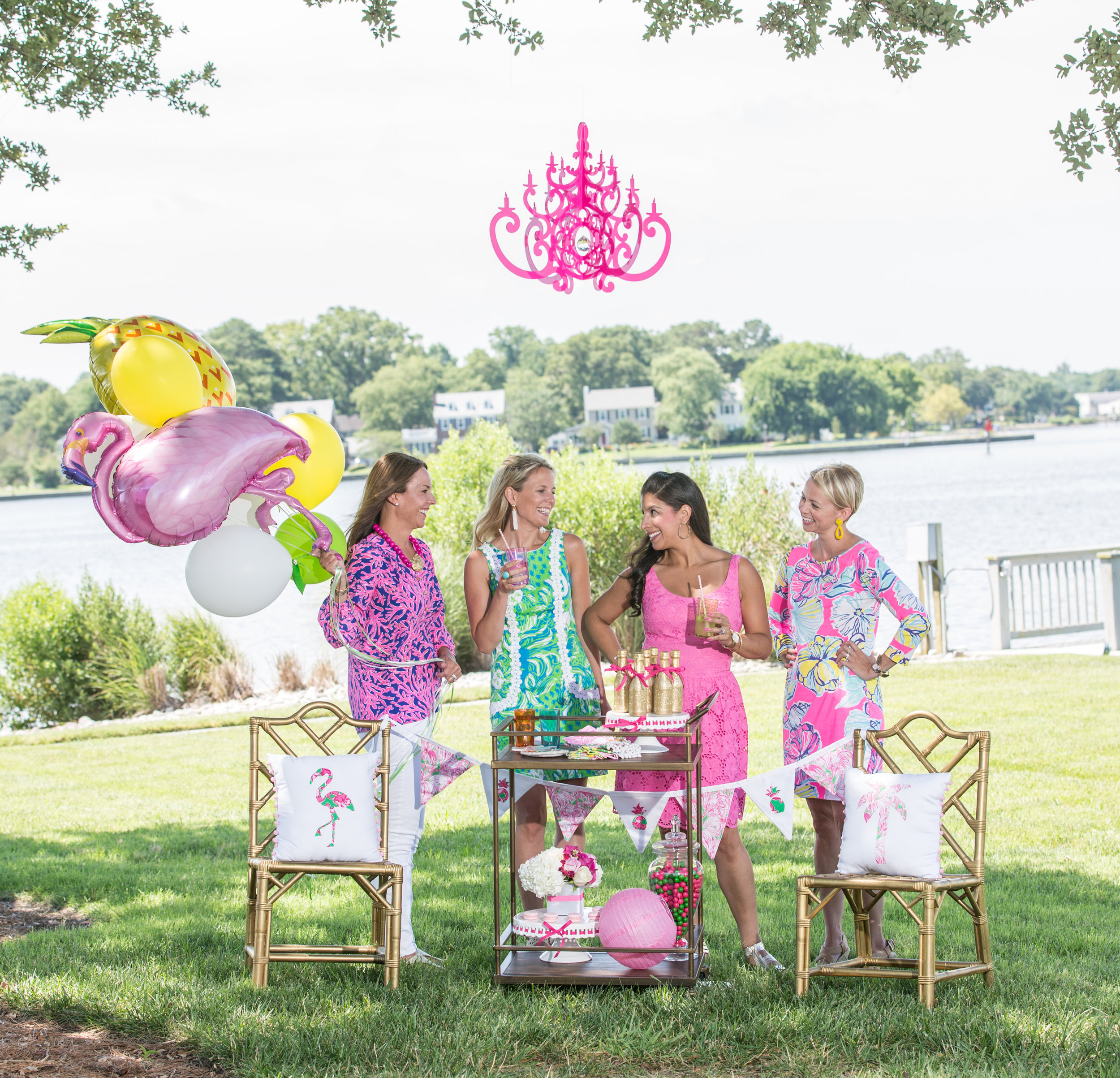 Pink flamingo balloons, pink dresses, pink shirts, pink candy, pink chandelier.