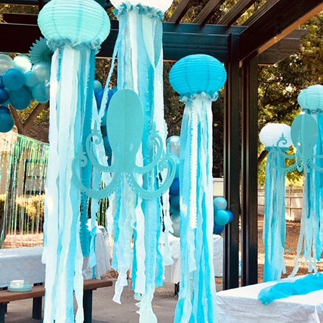 More from this #undertheseaparty with @therevelryco Loving how our Turquoise Octopus Chandeliers are hanging with some pretty jellyfish decor. #turquoise #thursdayparty #instaparty #underthesea #jellyfish #octopus #chandeliers #diydecor #diypartydecor #mypartystyle #mermaidparty #mermaidpartyideas #kidspartyideas #kidsbirthdays #kidspartyplanner #eventplanning #nauticaldecor #nauticalparty #shadesofblue #moderndecor
