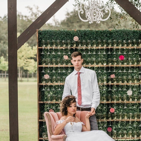 This #pinkcactus styled wedding shoot was dreamy, full of soft palettes and dramatic. We were lucky enough to have one of our White Fancy Acrylic Chandeliers styled over this awesome champagne wall. Isn't this couple gorgeous? More to come in the next few days! ⠀⠀⠀⠀⠀⠀⠀⠀⠀ Photography, Concept and Planning: @terrieimages Day of Coordinating: @cxteventco Florals: @pineandpetalweddings Venue: @theorangeblossombarn Stationary: @wildivoryandco Videography: @fireflymediafl Flower Girl Dress: @monbebecouture Beauty: @bellabyyanice Cake and Sweets: @sweetmissvs Custom Chocolates: @myfavoritesweetsfavors Rentals: @southernchairs  Mobile Bar: @sippingnomads Styling Mats: Chelseafarnercompany Styling Trays: @terrieimagesshop Ring Box: @thevelvetgardenringbox Models: @abby_kadabbie96 @huntercprince @jamie.thomp @andrewgarcia.21 @grachizaguirre #diyweddingdecor #diywedding #diypartydecor #chandeliers #champagnewall #bridalparty #brideandgroom #brideandgroomtobe #pinkwedding #modernwedding #modernweddings #modernweddingstyle #styledshoot #weddingshoot #eventplanner #eventplanning #weddingplanner #weddingplanners #fallwedding #whitechandelier #weddingideas