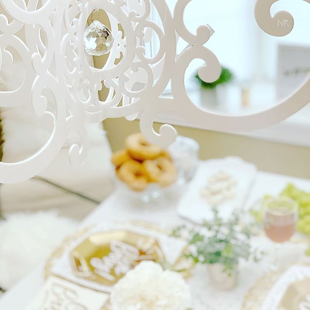 The sweet Oh Baby baby shower, styled by @erikamariedesigns using our White Fancy Chandelier and incorporating donuts, fancy gold paper plates and the sweetest floral touches is on the blog. I love how she used minimal but intentional decor to have a glamorous baby shower. Who says it has to be all pinks or blues? #babyshower #babyfever #babystyle #babyshower #babyshowerideas #babyshowertheme #whitedecor #whitedesign #chandelier #diydecor #moderndecor #diybabyshower #diybaby #tablescapes #tablescapestyling #donutparty #babyshowerthemes #eventplanning #pastelparty #partystylist #partydecorations #softshades #whiteparty #babydecor #babydecoration #momtobe #expectingmom #expectingbaby #expectingababy