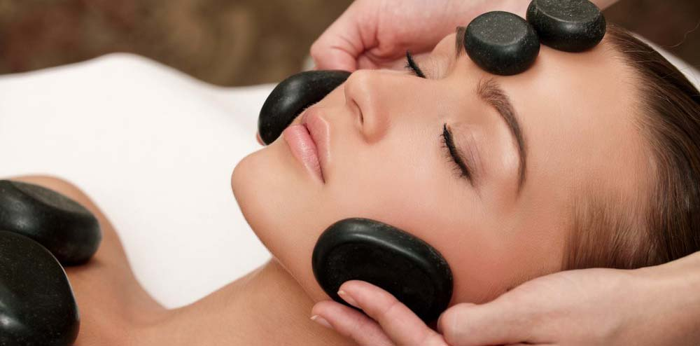 stock-photo-woman-lies-on-a-table-in-a-beauty-spa-getting-a-treatment-86826973.jpg