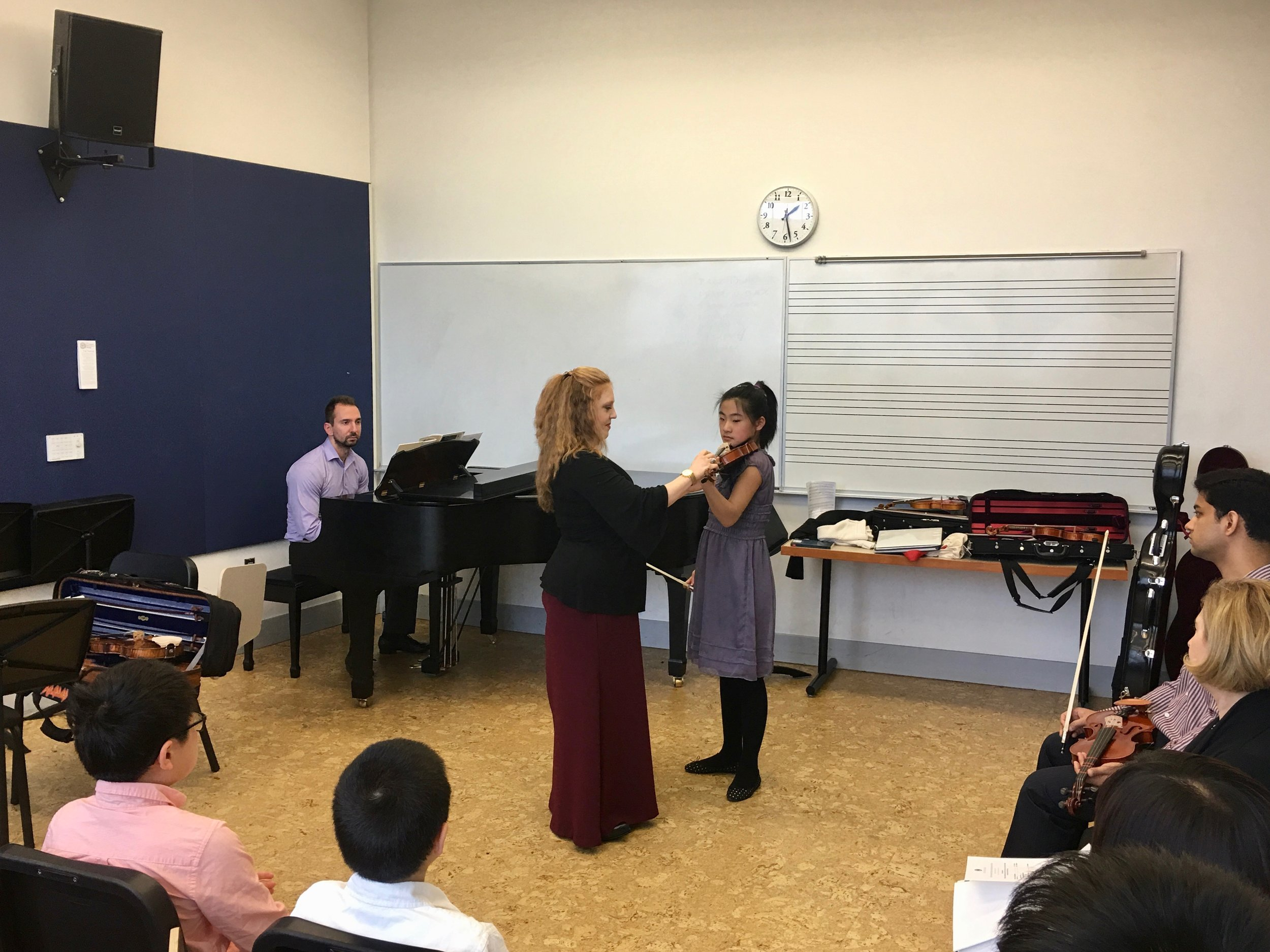 Angela and Rachel work on Minuet 1 by Bach.