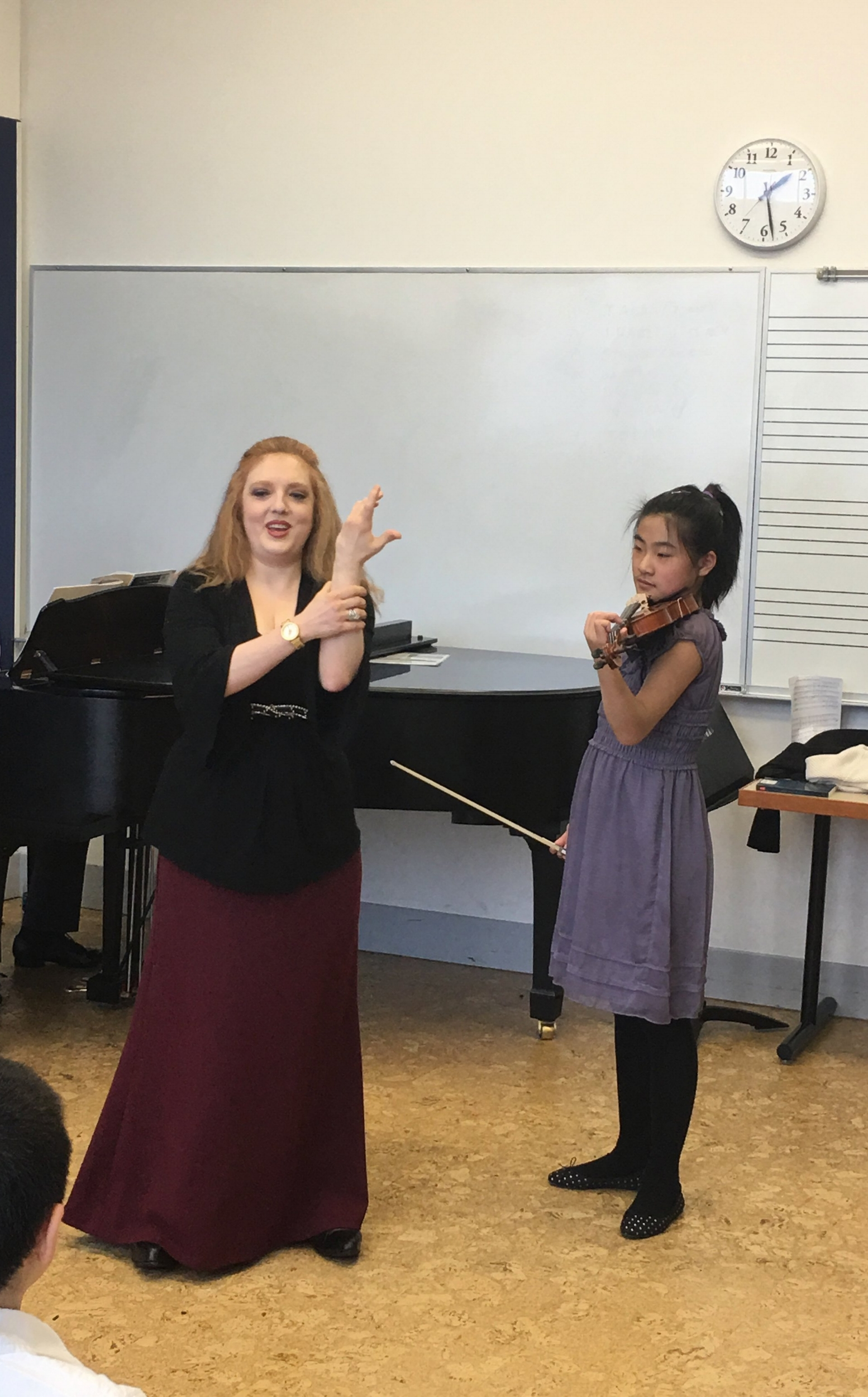 Angela learns about some of the odd ways violinists must contort themselves!
