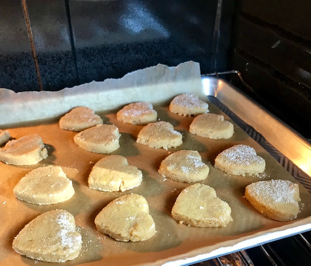 coconut cut out cookies in oven.jpg