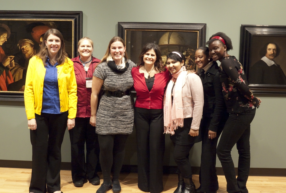 "PSI founder (Dr. Lamis Jarvinen (center)) with Mount Holyoke College undergraduate students partaking in her ""Science of Art"" initiative at Mount Holyoke College Art Museum.  Photograph courtesy of Ellen Alford, Coordinator of Academic Affairs, MHC Art Museum"