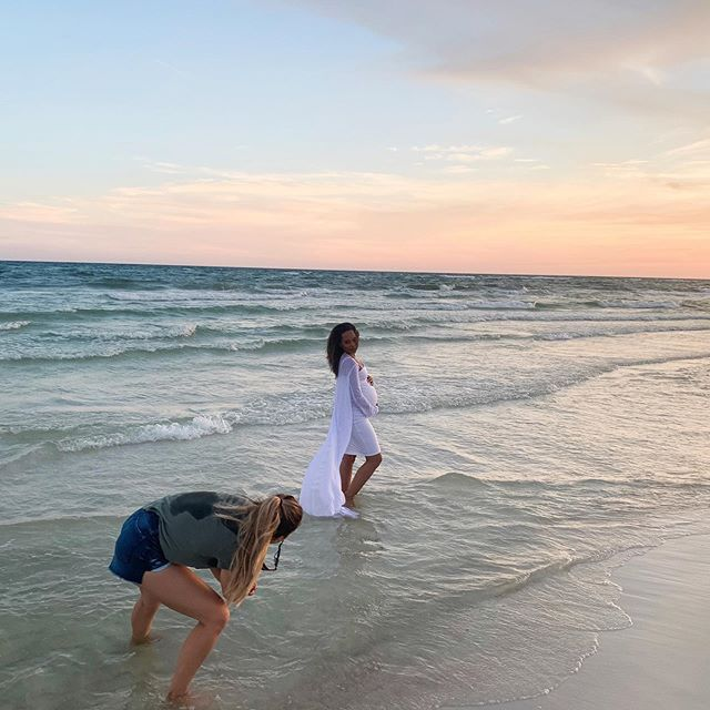 "My hubby snapped this BTS 📸 of @ashleypigulskiphotography capturing my maternity photos! I'm officially in my 3rd trimester something about this moment made me feel ""ready"" to meet my baby 💛 While I was trying to stay calm, poised, and relax there were many moments where the waves were crashing into me sometimes even knocking me over. I closed my eyes, focused on my breathe and riding each wave with my baby as calm as possible. In this moment it was for the sake of looking cute in my photos lol... but the whole thing was a beautiful metaphor I've etched into my memory to carry into my labor. Me & him so small in this vast ocean, God's beautiful creation surrounding us, Him controlling it all and watching over while I focused inward on my breath taking it wave by wave, moment by moment, my husband at the shore watching over as our protector. It was magical. ✨ We got this LC. Mom & Dad can't wait to meet you sweet boy! . . . #drlaurencollins#maternitystyle#maternityshoot#maternityphotography#healthypregnancy#fitpregnancy#holisticpregnancy#homebirth#mamatobe#babybump#munamommy#aftertheaisle#blackmomsblog#blackmomskillingit#wellnessblogger#dfwblogger#fortworthmom#fortworthblogger#fortworthmomsblog"