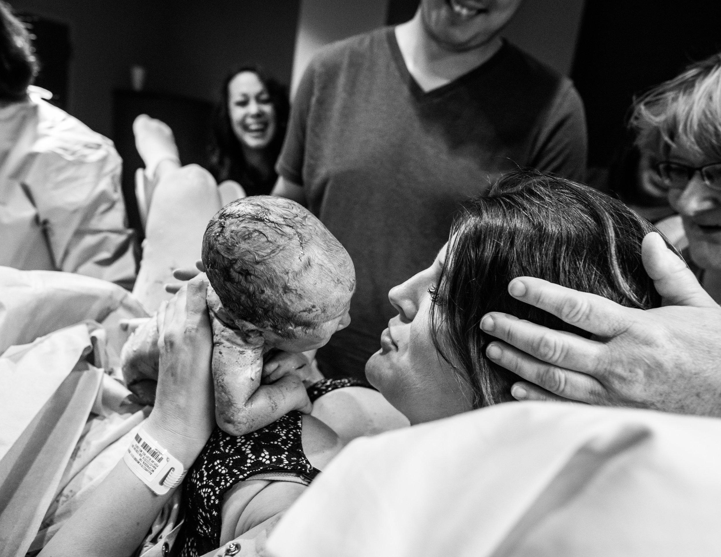 birth.photographer.poplar.bluff.black.white.newborn.first.touch