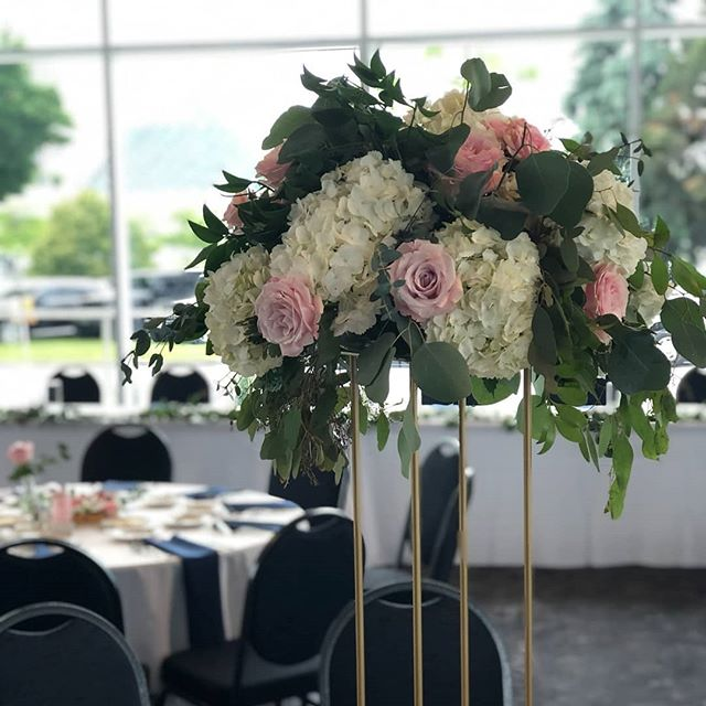 A few pictures from today's wedding at Discovery World in Milwaukee. #peonies #roses #eucalyptus #weddingflowers #greenbayflorist #willtravelforflowers #harlowstand #weddingcenterpieces