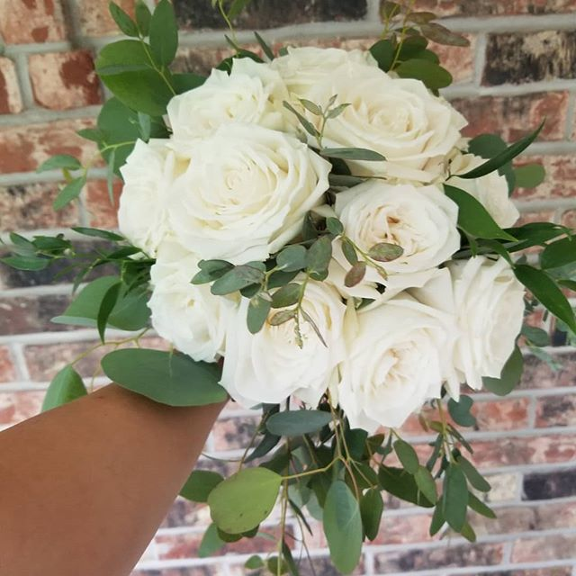Timeless beauty! One of many pretty bouquets from this week. #weddingflowers #bridalbouquet #whiterosebouquet #ivoryrosebouquet #eucalyptusbouquet #eucalyptus #greenbayflorist