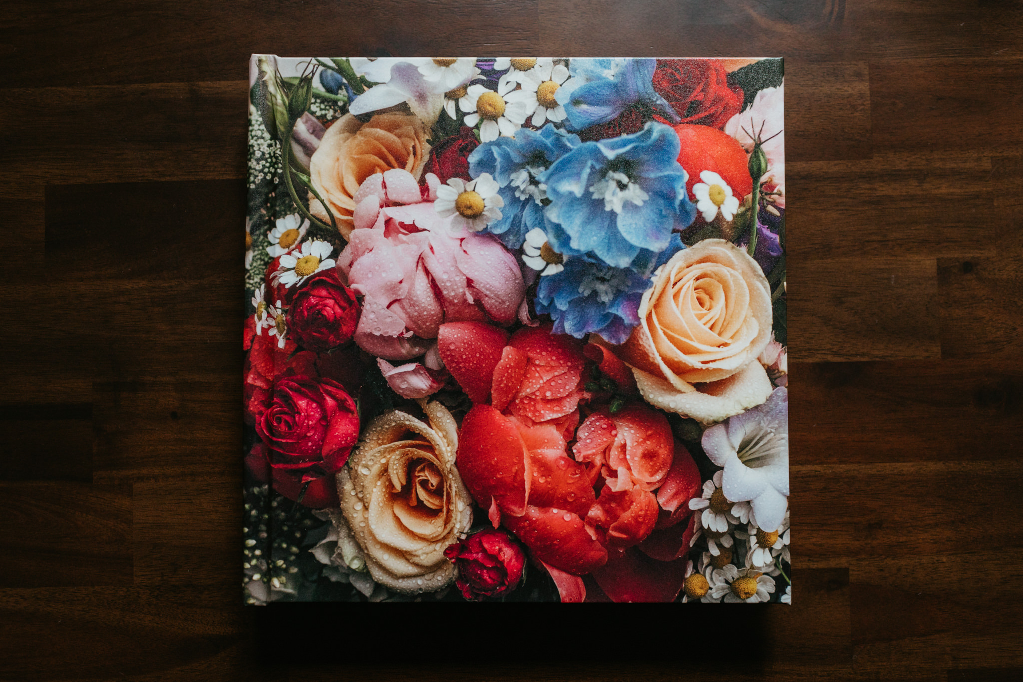 1. The Heirloom Album - The book, 12x12 inch: A printed hard cover, with thick seamles spreads allowing your favorite images to carry over the page. Its 50 pages beautifully tells the story of your wedding.