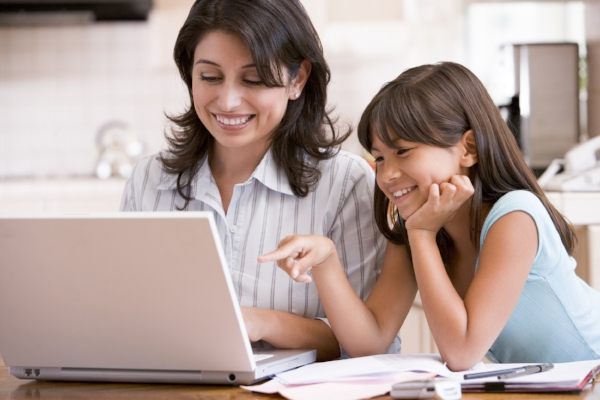 "photo credit: GSCSNJ <a href=""http://www.flickr.com/photos/44102337@N03/7882614208"">Woman and young girl in kitchen with laptop and paperwork smiling</a> via <a href=""http://photopin.com"">photopin</a> <a href=""https://creativecommons.org/licenses/by-nc/2.0/"">(license)</a>"