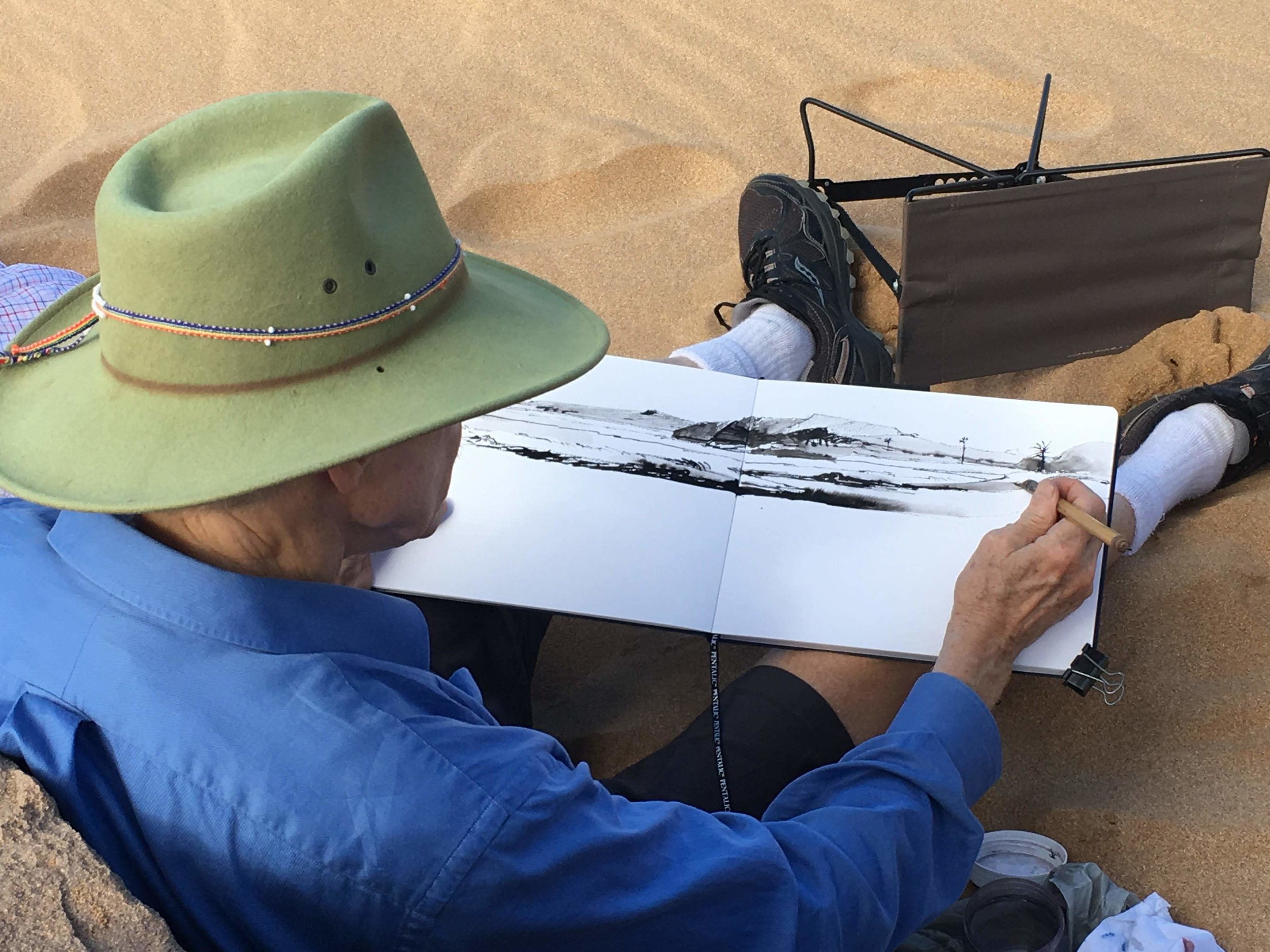 Robert demonstrates how to do an ink painting of the view from Big Beach.