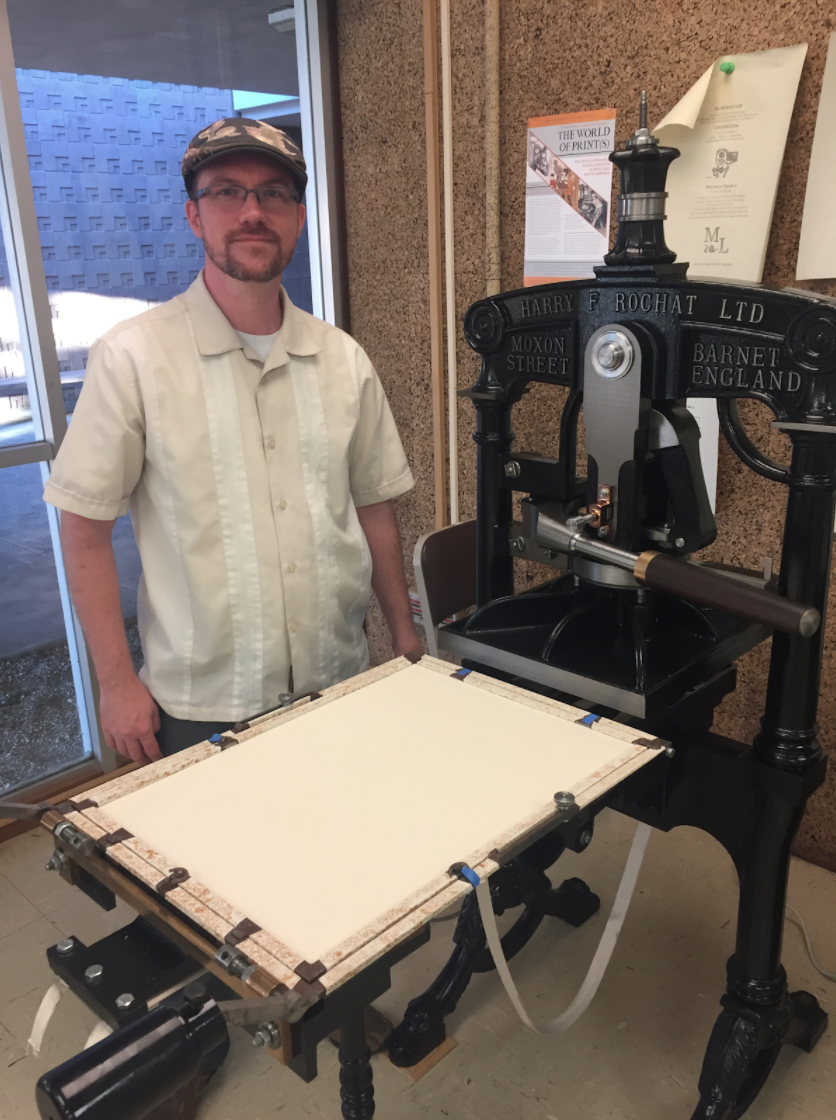 Faculty Director of the DAHC Jeremy Douglass with 'Mad Madge' herself - a 19th century Albion printing press.