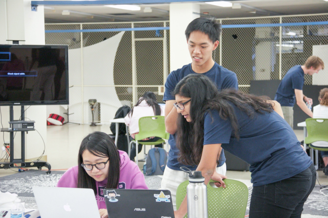 Participants of a Django Girls workshop code with the support of mentors from the Data Science club in the DAHC.