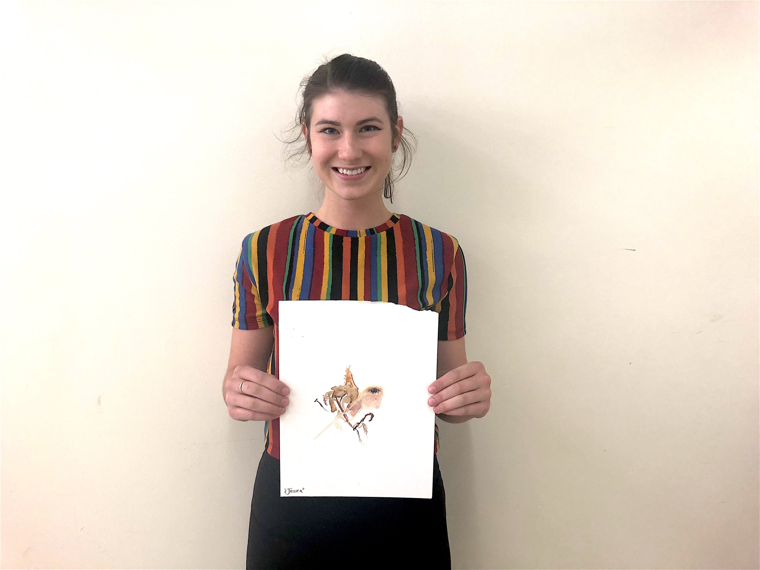 Jessica O'Brien holds her winning piece for a photo. (Photo by Sasha Nasir)
