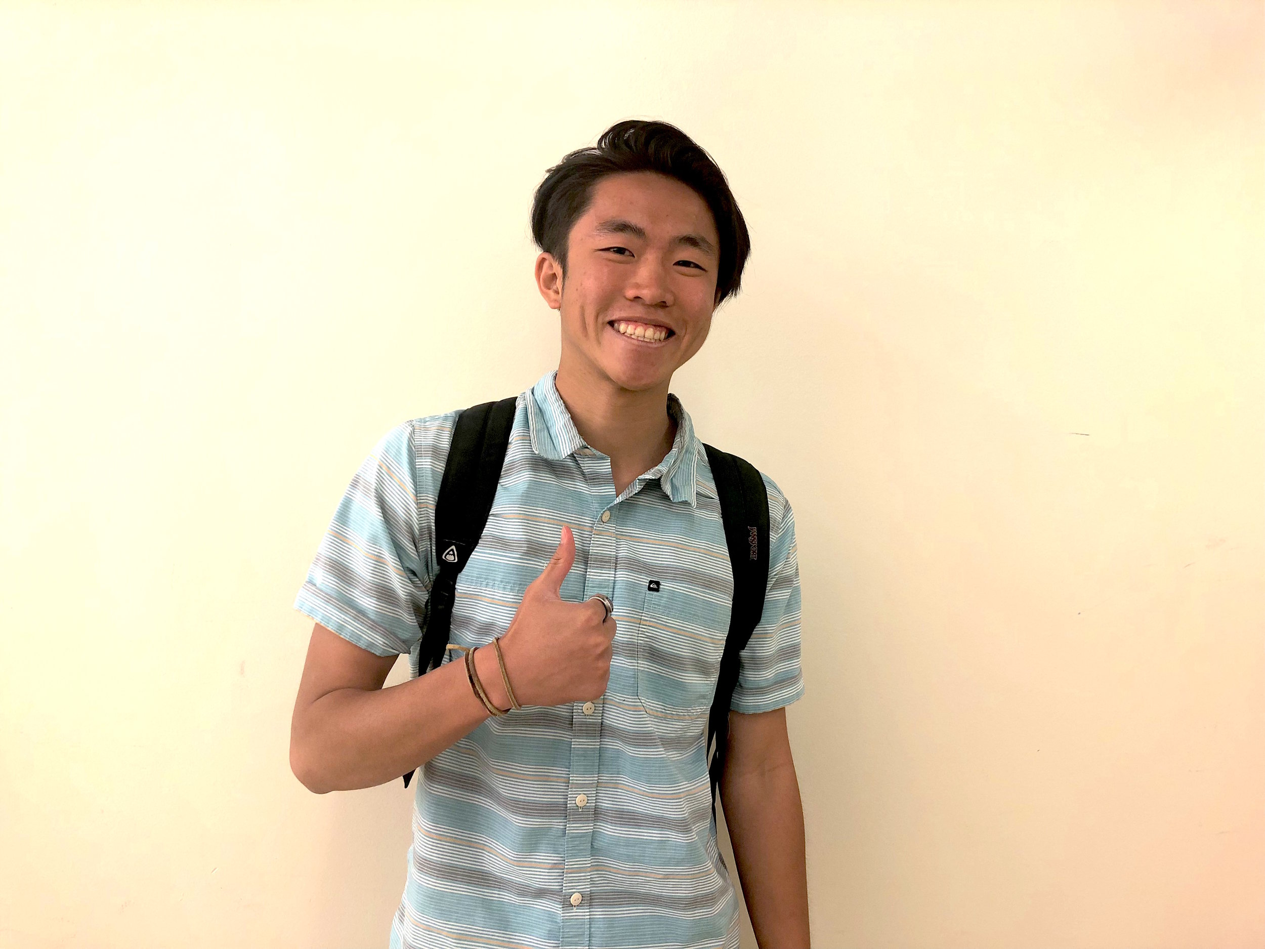 Andrew Nguyen gives a thumbs up to the camera. (Photo by Sasha Nasir)