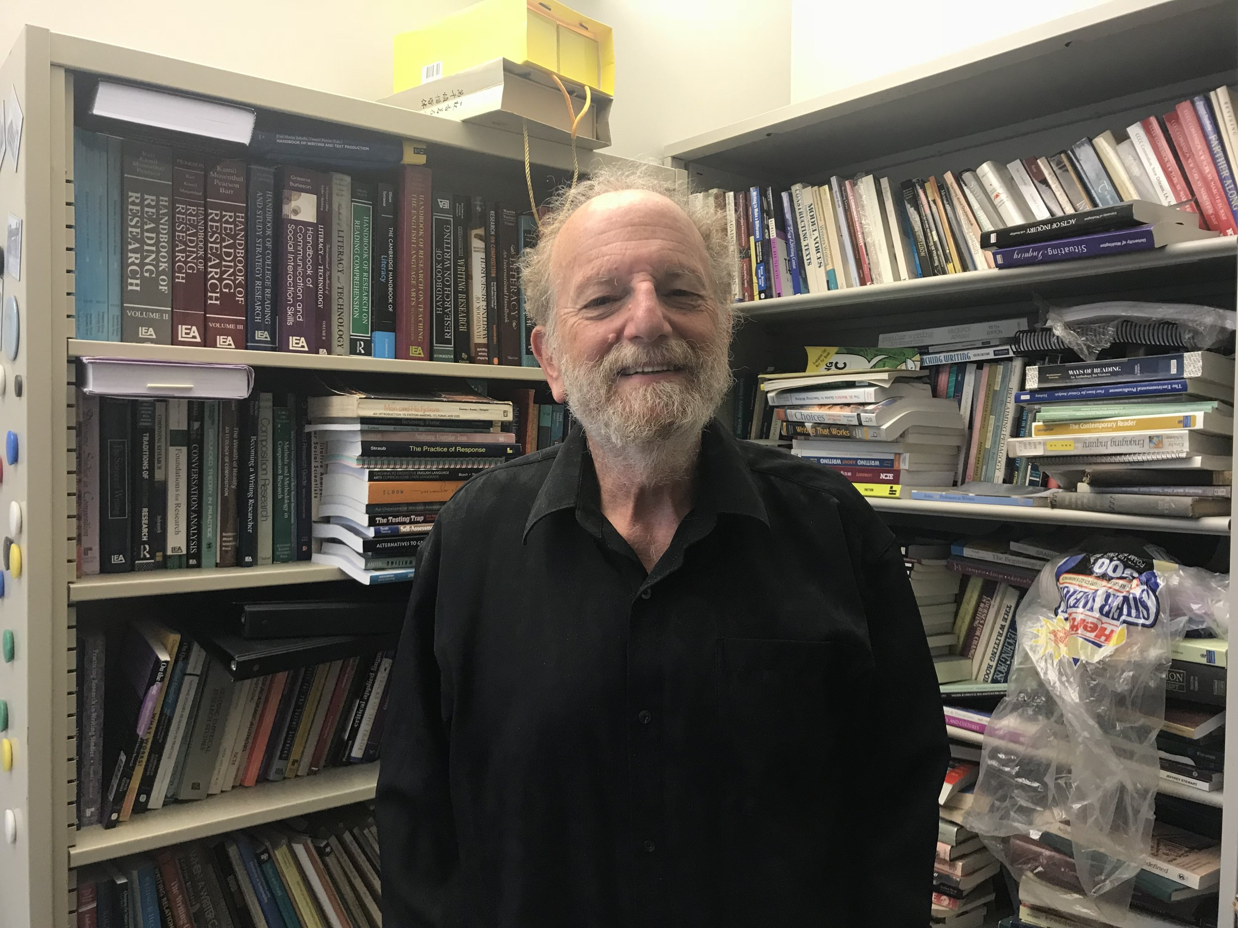 Education Professor and major donor Charles Bazerman in front of his collection of books.