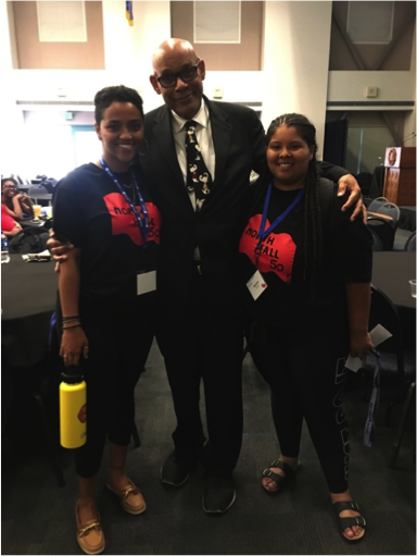 UCSB Black Studies professor Jeffrey Stewart stands with Black Student Union president Mariyah Lewis and third-year student Alexandra Gessesse before an intergenerational alumni and student dialogue panel commemorating the North Hall Takeover.