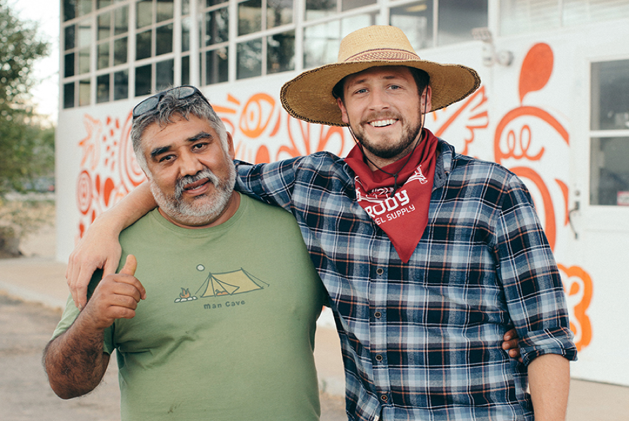 Founders of Isla Vista Screen Printing and Embroidery Jose Cardoso (left) and UCSB alum Garrett Gerstenberger (right) at their print shop in New Cuyama, California.