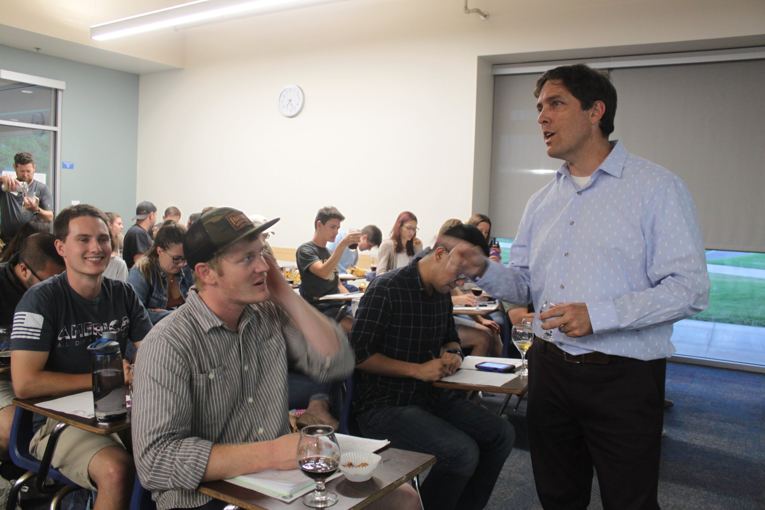 Religious Studies alumnus Brian Yaeger answers questions from students in between beer tastings during his Beer 101 class, offered by UCSB's Recreation Department.