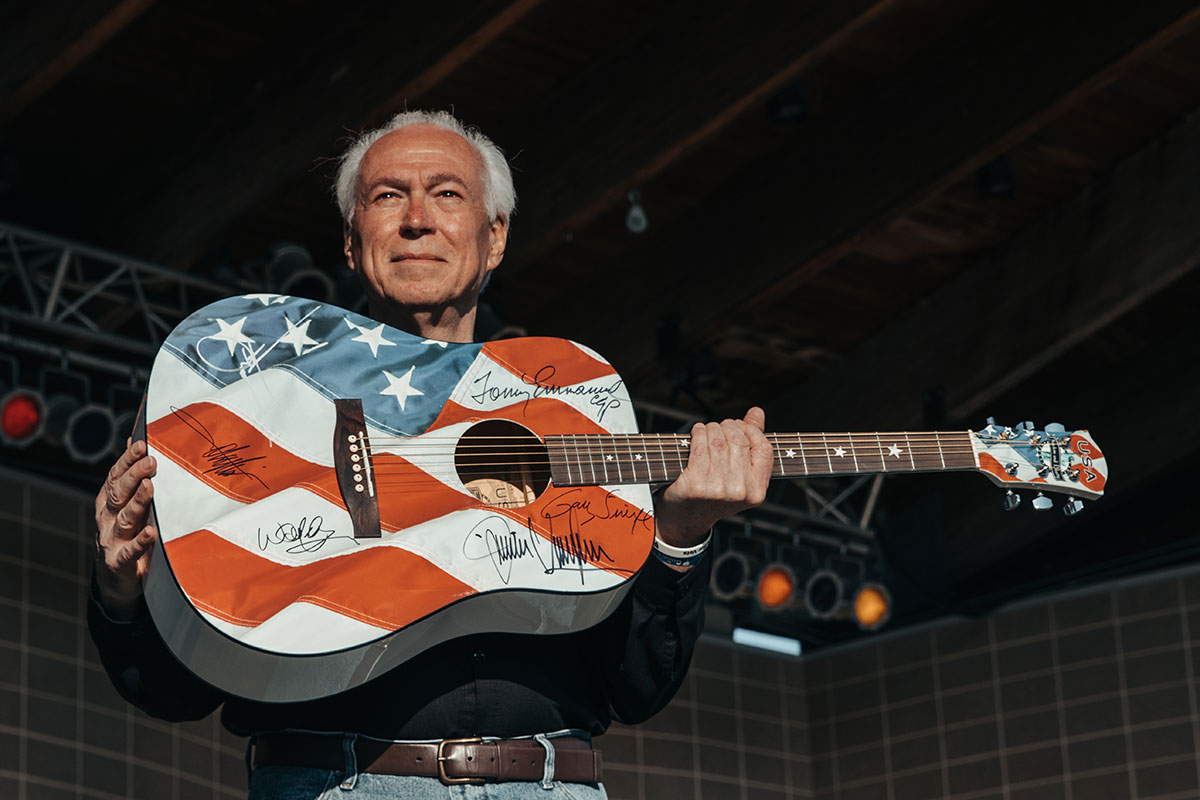 David-holding-Patriotic-Guitar.jpg