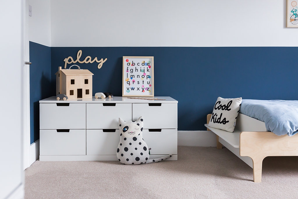 Storing toys away in concealed units will help to create a restful sleep environment. Photo Credit: Leo & Grace