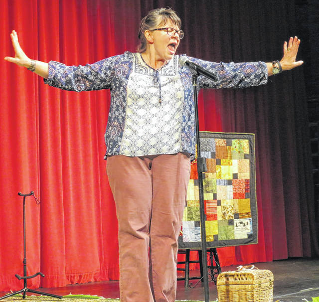 Lona Bartlett, a storyteller and puppeteer from Charlotte, is a study in emotion while performing on the Andy Griffith Playhouse stage Saturday during the Tarheel Tellers Storytelling Festival.