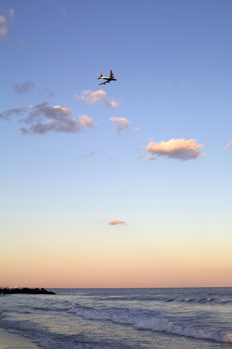 plane-flying-at-sunset-over-beach.jpg