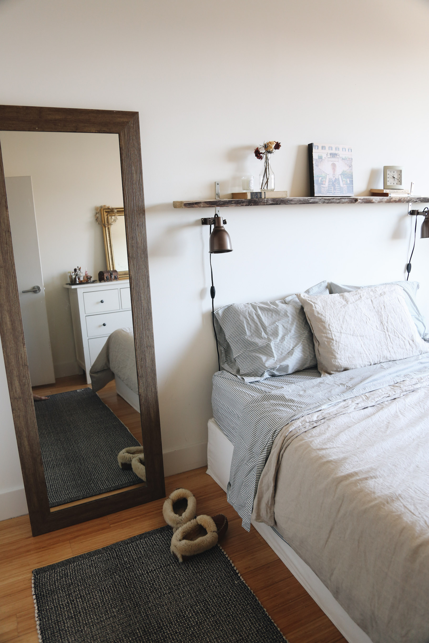 I mentioned our  mirror ,  sheets  and  duvet cover  above, but wanted to point out our reversible  rug  that we alternate between the entry space and my bedside.