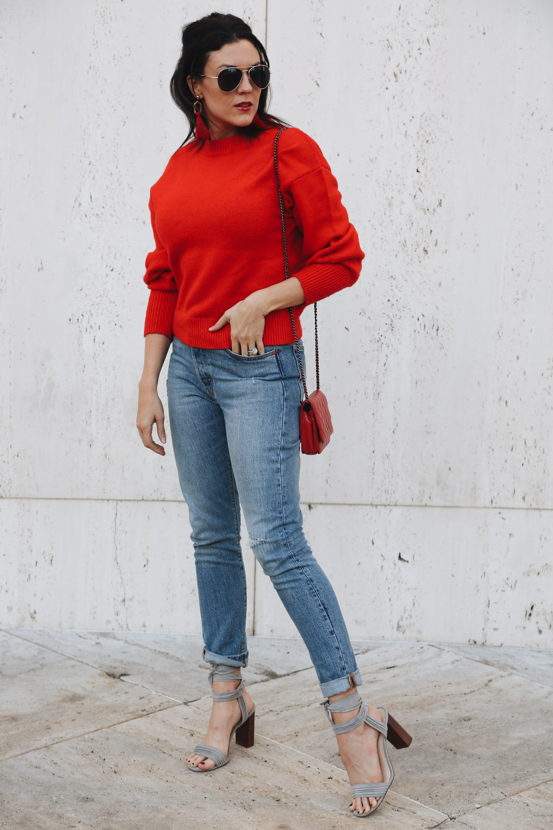 A Casual Holiday Outfit Red Sweater Jeans Runway Chef