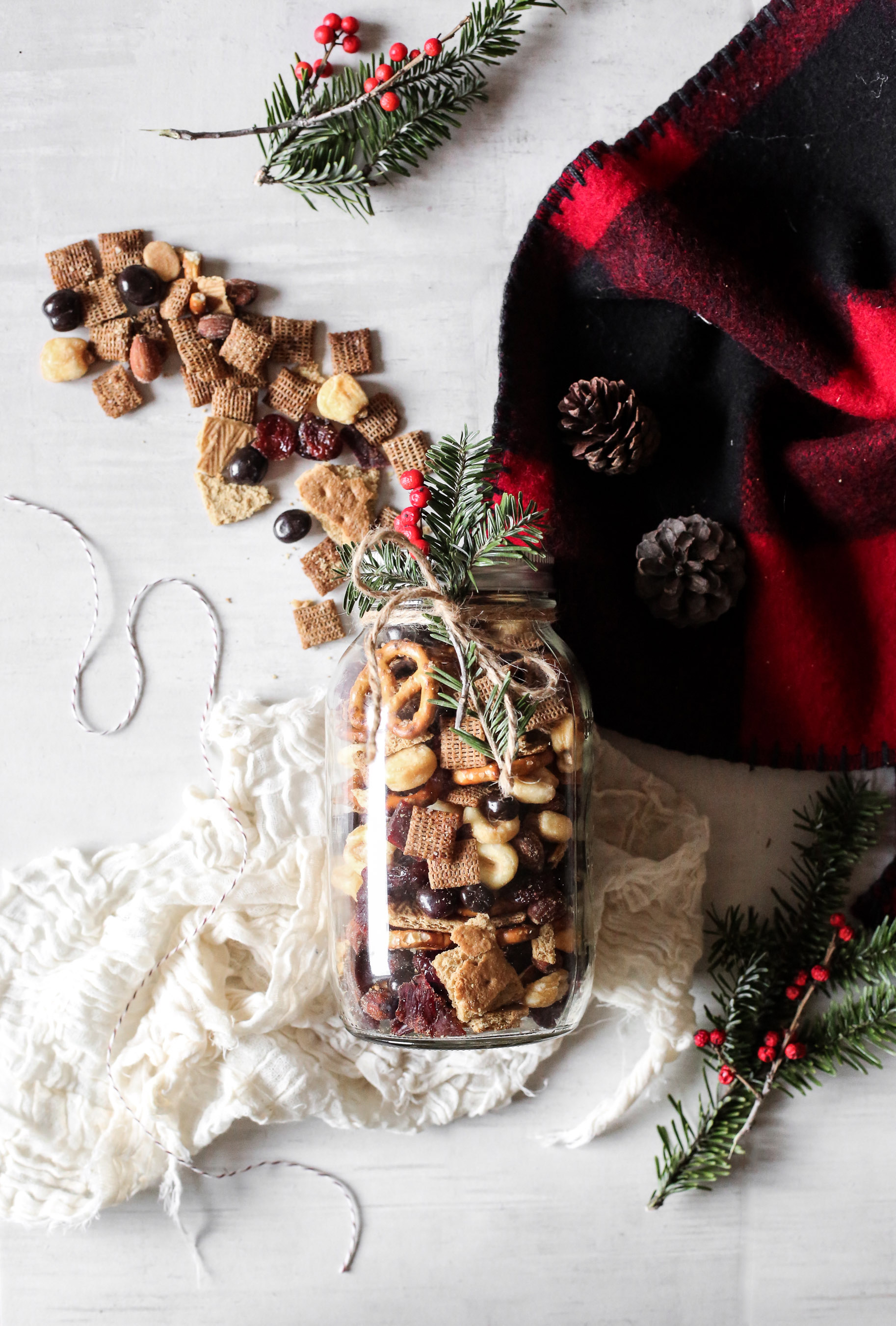 MOUNTAIN TRAIL MIX - A trail mix that's equal parts smokey, crunchy, spicy and sweet aka what you'd want to be eating in a cabin, on a mountain trail, or, ya know, just at a cozy Christmas party. This can be made over a week in advance, but it might not last a full week in your house (It didn't in ours.) so plan accordingly if you're making it in advance for a party.