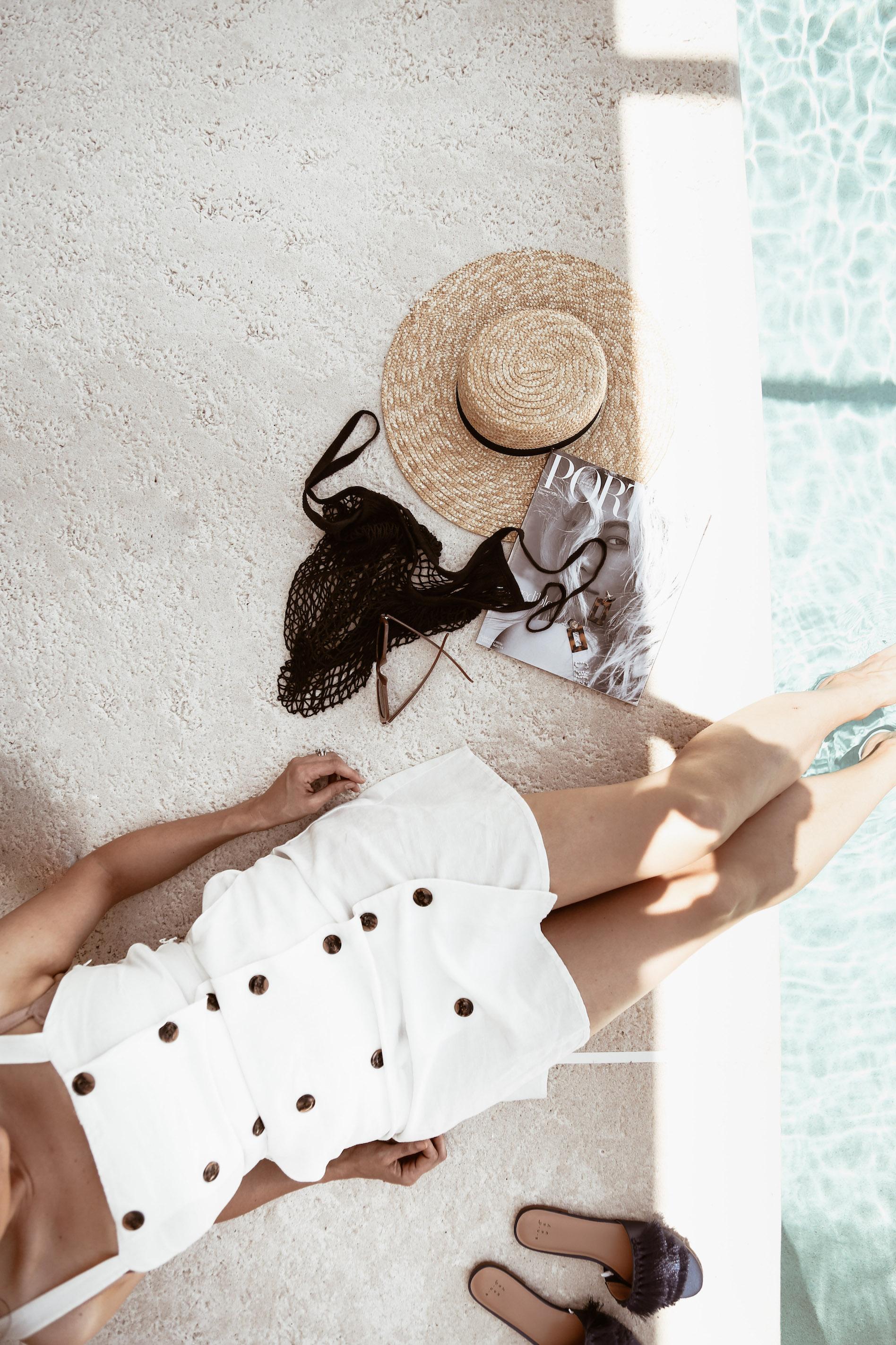 white linen dress with dark buttons.jpg