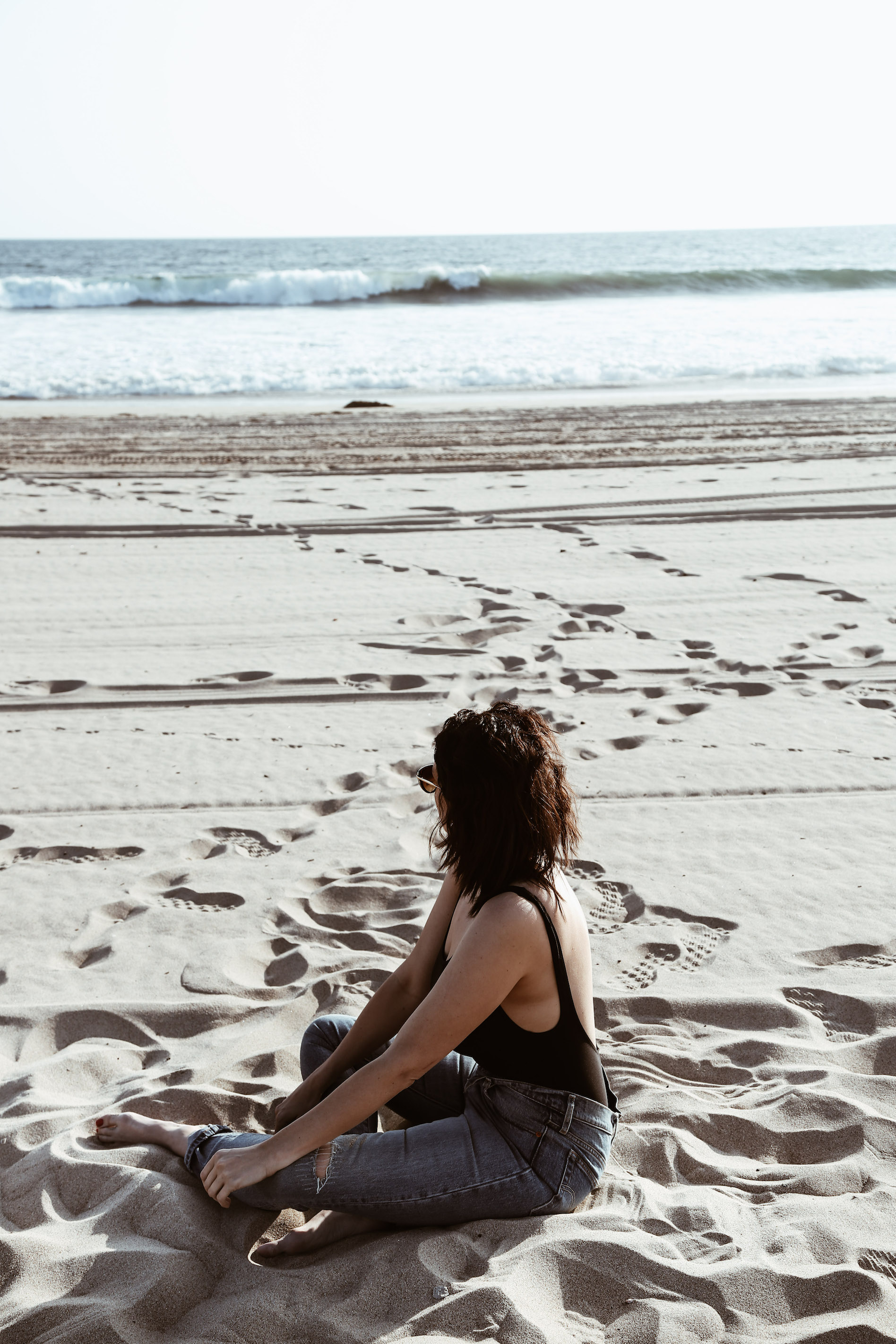black one-piece swimsuit and levis on the beach3.jpg