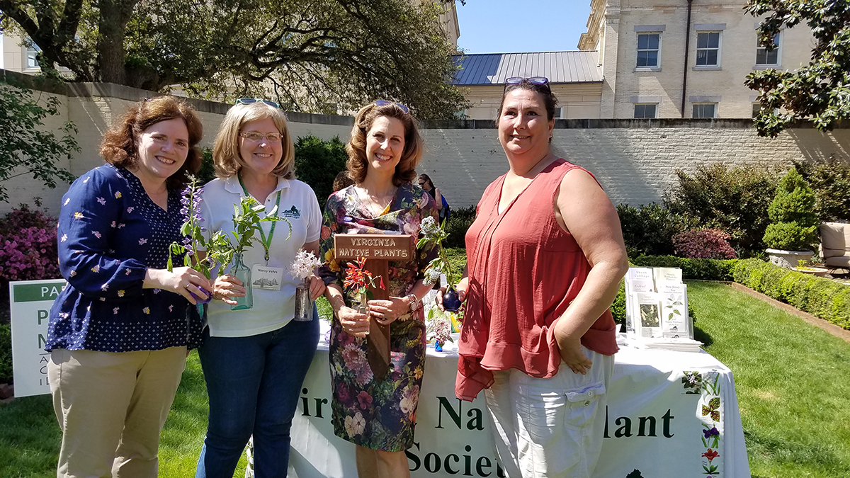 "Executive Mansion - Garden Day. Presenting First Lady Pam Northam with a ""Virginia Native Plants"" sign for the Mansion's gardens. (l to r) Virginia Witmer, Virginia CZM Program and DEQ; Nancy Vehrs, president, Virginia Native Plant Society; First Lady Pam Northam; Leslie Allanson, president, Pocahontas Chapter, VNPS. Image courtesy of the Office of the Governor."