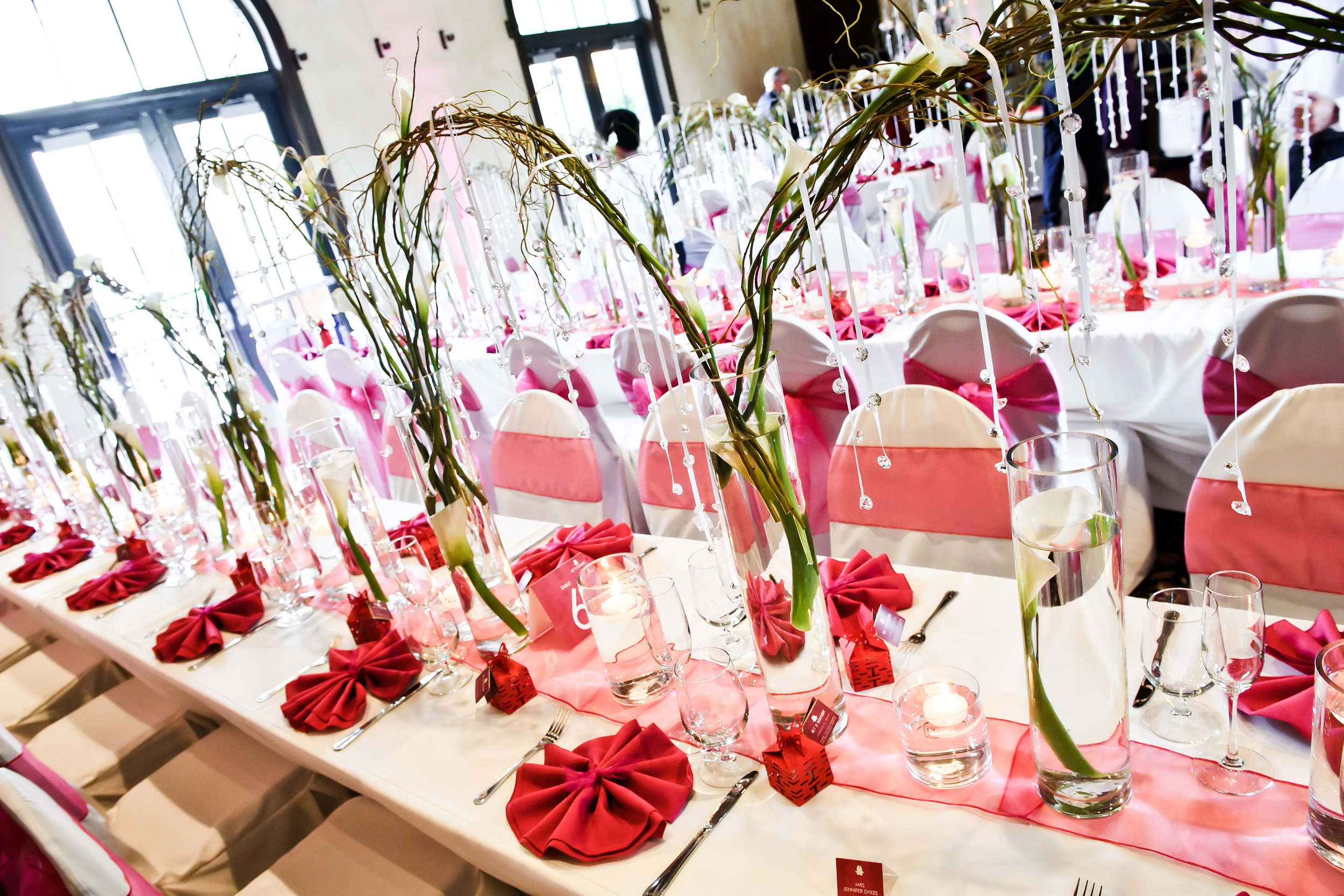 Centerpieces Tall Vase Blanc Calla Lilies Hot Pink Setting (2).jpg
