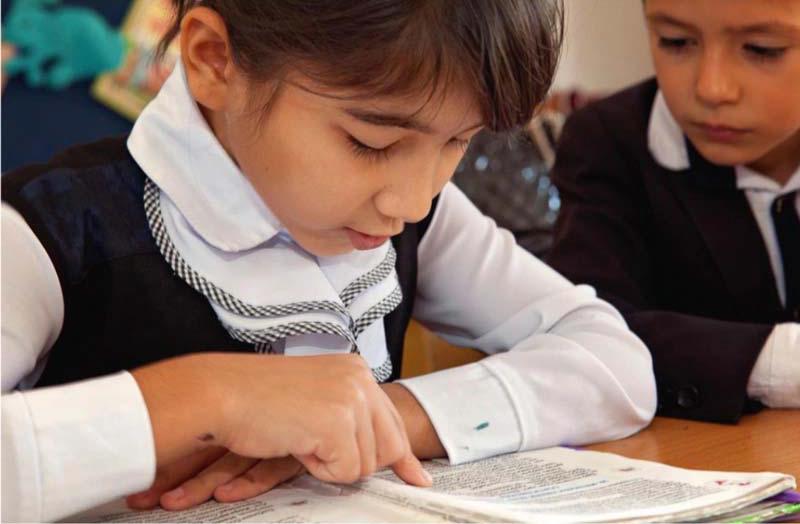 Tajik girl reading silently.jpg