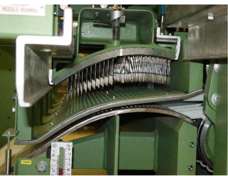 close up Industrial needle felting machine showing needle bed