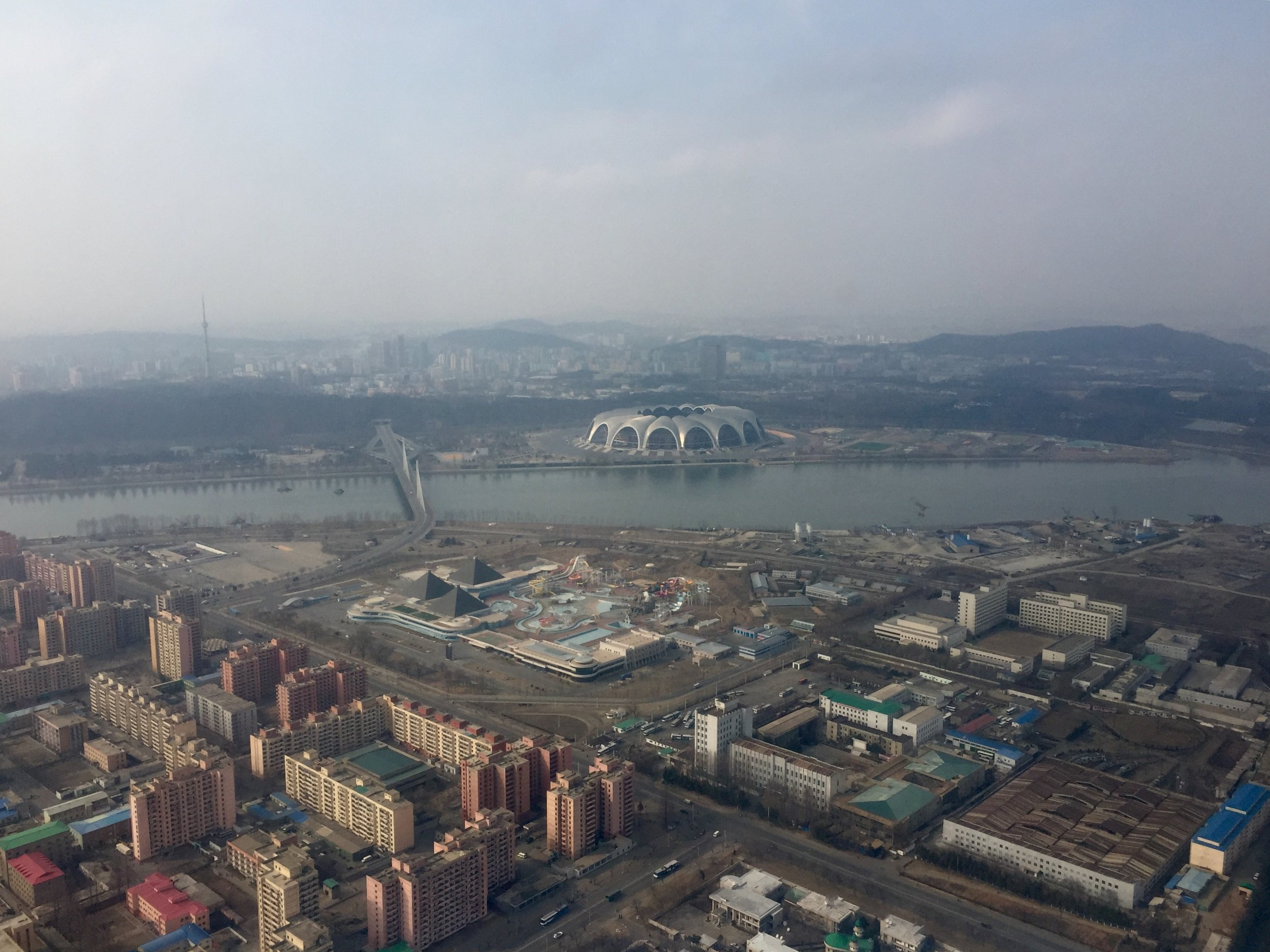 A view of northern Pyongyang as taken from an Air Koryo helicopter. The state-owned Munsu Waterpark can be seen in the foreground, and across the river is Mayday Stadium, the world's largest by capacity with 150,000 seats. (Photo by Ethan Jakob Craft.)