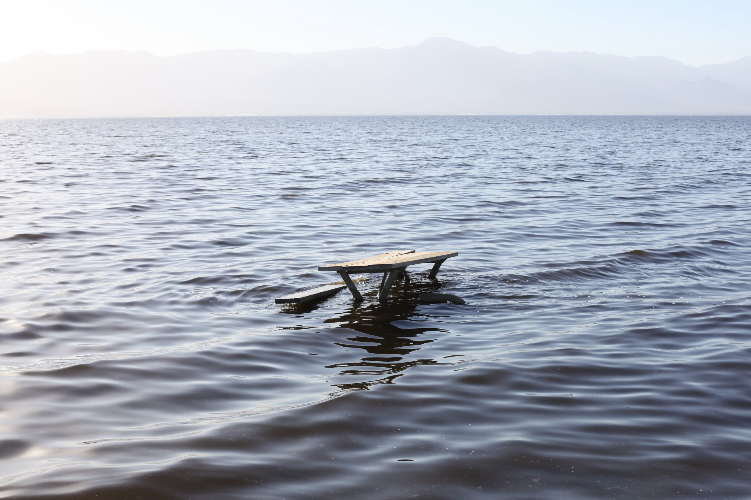 A damaged picnic table sits partially underwater during high tide at Mecca Beach on Jan. 6, 2017.(Photo by Ethan Jakob Craft.)