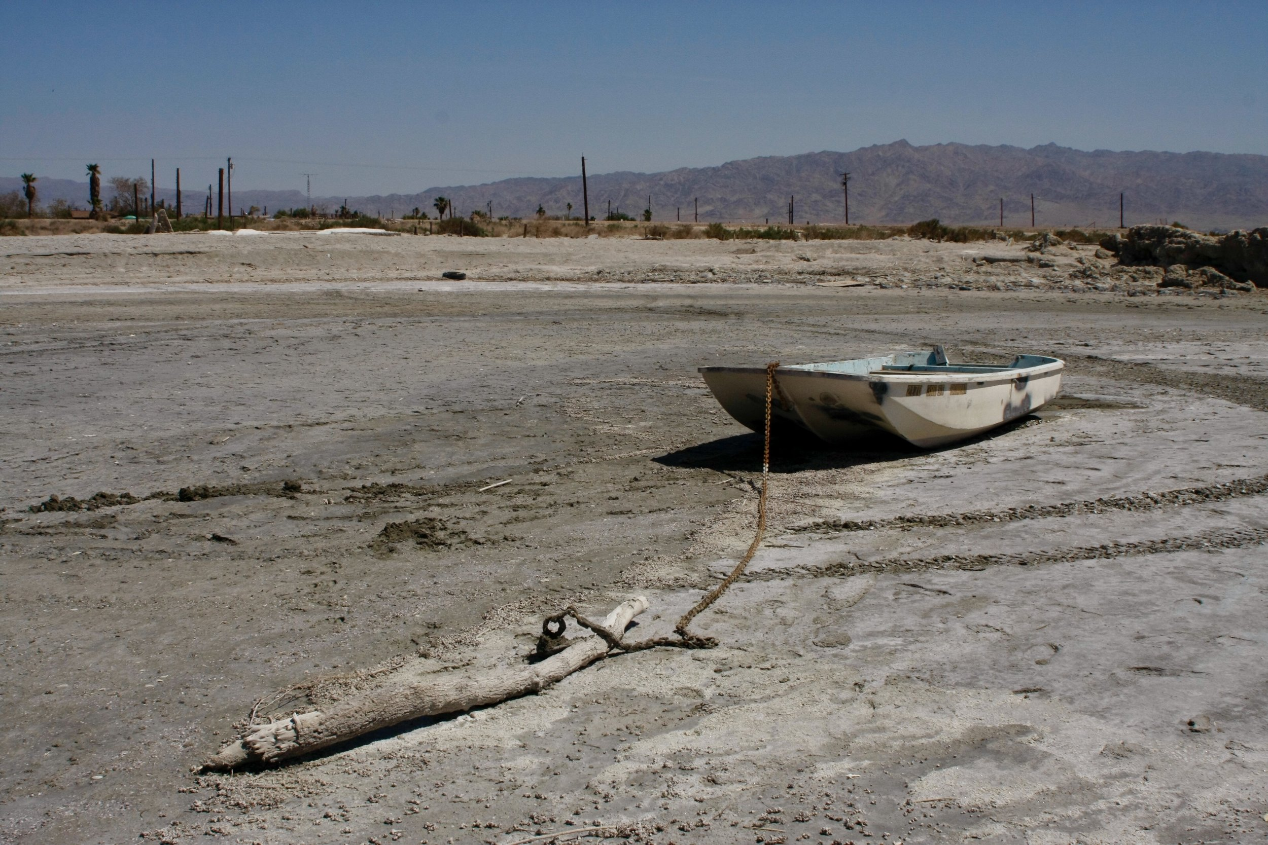 A rowboat sits abandoned on a dry lakebed near the community of Bombay Beach, Calif. on May 17, 2017. (Photo by Ethan Jakob Craft.)